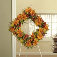 Orange Asiatic Lilies, Red Alstroemeria & Green Hypericum Square Standing Wreath by America