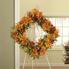 Orange Asiatic Lilies, Red Alstroemeria & Green Hypericum Square Standing Wreath by America's Funeral Florist