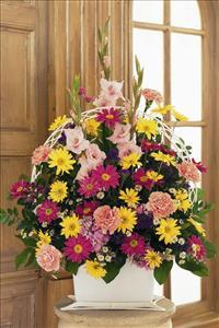 Spring Colors in Funeral Basket by America