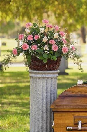 Basket with Pink Flowers by America's Funeral Florist