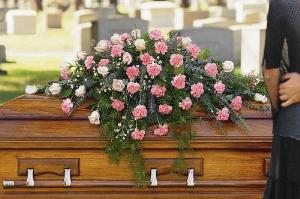 Closed Casket Pink Spray by America's Funeral Florist